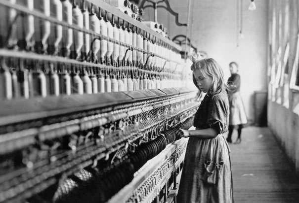 Girl working at a cotton mill | history of labor day at alittleperspective.com